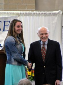 Amber Pickel receives congratulations from Herb Kohl. (2)