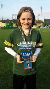 Makenna Schooff wins first place in Punt, Pass, Kick