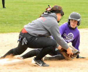 Lady Cardinals split doubleheader