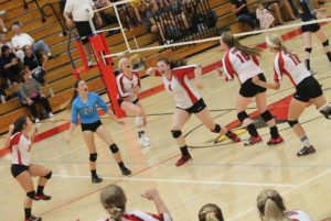 Cardinals volleyballers trip up Trojans
