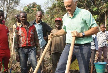 SUBMITTED PHOTO The Independent-Register Tony Ends works soil with a broad fork in a market garden of a village in Guinea, West Africa, earlier this year, while serving a second time with the Peace Corps as a UN field officer with the World Food Programme.