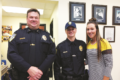 ERICA GOKEY PHOTO Independent-Register Brodhead Chief Chris Hughes, Officer Tylor Hoard, and Hoard's fiancée Taylor.