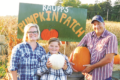 ERICA GOKEY PHOTO The Independent-Register The Raupp's stand next to their pumpkin stand. From left: Jessica Raupp, Lily Raupp, and Brian Raupp