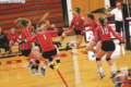 BECKY MALKOW PHOTO The Independent-Register The Lady Cardinals celebrate a service ace in their come from behind win in game one vs. Egderton.