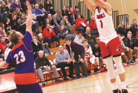BECKY MALKOW PHOTO The Independent-Register Cade Walker drills three of his game high 26 points vs. Albany last weekend.