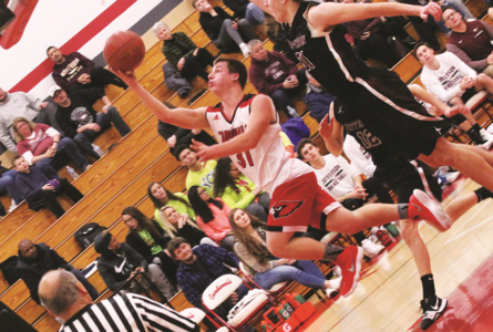 BECKY MALKOW PHOTO The Independent-Register Ben Knuth weaves his way to the basket for two points.