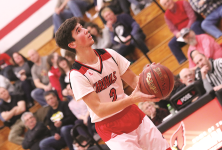 BECKY MALKOW PHOTO The Independent-Register Josiah Kloepping hits a pair of free throws after East Troy's Darryl Rayfield was given a technical foul.