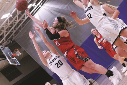 BECKY MALKOW PHOTO The Independent-Register Kiarra Moe hits a floater on the fast break.