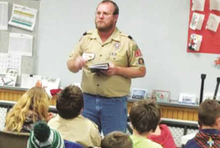 JEREMY GOKEY PHOTO The Independent-Register Cubmaster Mike Visger, of Pack 108, leading a pack meeting.