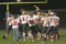 BECKY MALKOW PHOTO Independent  Register Brodhead/Juda Football 	The players raise Coach Matthys in celebration fol-lowing their 28-0 win over Clinton Friday night.