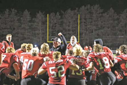 MANDY FIELDS PHOTO Independent Register Brodhead v. Whitewater Head Coach Jim Matthys gives the traditional end zone boom after the Cards come up strong for Homecoming.