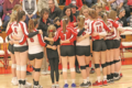 BECKY MALKOW PHOTO Independent Register The Lady Cardinals huddle up prior to their regional game Thursday night vs. New Glarus. They Cardinals were victorious 3-0 over New Glarus and host Cuba City at home Saturday night.