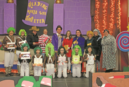 """COURTESY PHOTO Independent Register Reading Makes Life Sweeter Willy Wonka and his Oompas open the Albrecht Elementary Motivational Reading Program, """"Reading Makes Life Sweeter"""" with a celebratory school assembly."""