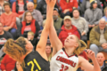 MANDY FIELDS PHOTO Independent Register Lady Cards v. East Troy Abbie Dix gets up for the tip off as the Lady Cards get back to conference play after the winter break.