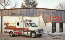 COURTESY PHOTO Independent Register Brodhead Area EMS First modular ambulance purchased in 1998 by the Brodhead Area EMS in front of the then three year-old EMS building.
