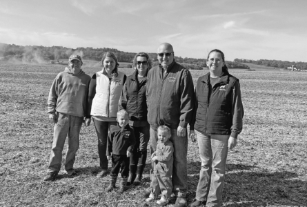 SUBMITTED PHOTO The Independent-Register Members of the Brewer family gather for a photo in the soybean field on harvest day. The adults, from the left, are Tony Brewer, Nicole Brewer, Tami Behnke, Brian Behnke and Traci Brewer with youngsters Jaxson and Kinslee.